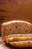 Sliced whole wheat bread on cutting board Royalty Free Stock Images