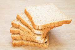 Sliced whole wheat bread on wooden background Stock Images
