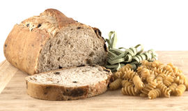 Sliced whole wheat olive bread and pasta Royalty Free Stock Photography