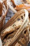 Sliced wholegrain bread in a wicker basket Stock Image