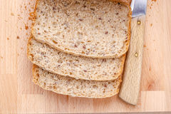 Sliced wholemeal bread on cutting board Royalty Free Stock Image