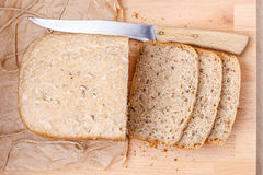 Sliced wholemeal bread on cutting board Royalty Free Stock Images