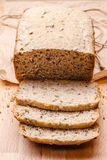 Sliced wholemeal bread on cutting board Stock Image