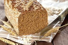 Sliced wholemeal bread on dishtowel Royalty Free Stock Photography