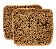 Sliced wholemeal rye bread isolated on a white background. Two sliced wholemeal rye bread isolated on a white background, closeup Stock Photography