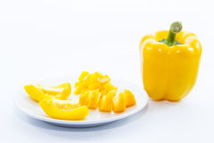 Sliced yellow bell chili ingredient on white plate Royalty Free Stock Photos