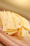 Sliced yellow cheese Stock Images