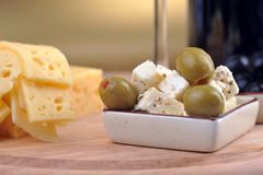 Sliced yellow cheese an olives Stock Images