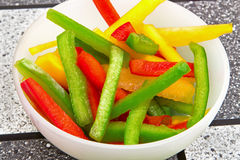 Sliced yellow green red paprika Royalty Free Stock Photos
