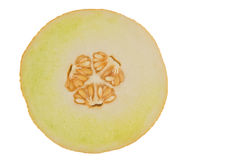 Sliced yellow melon isolated in white Royalty Free Stock Image
