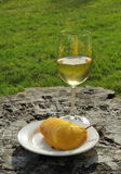 Sliced yellow pear and glass of wine Stock Image