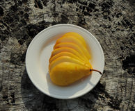 Sliced yellow pear Stock Images