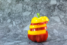 Sliced yellow and red bell pepper Stock Photos