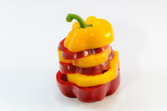 Sliced yellow and red bell pepper on white background Royalty Free Stock Photography