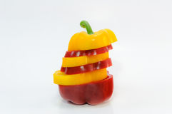 Sliced yellow and red bell pepper on white background Stock Photography