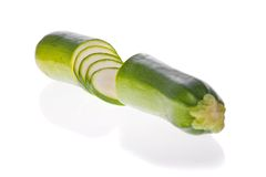 Sliced zucchini or courgette isolated on white Stock Photos