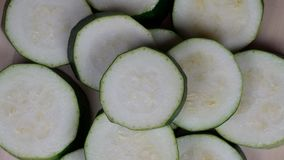 Sliced zucchini courgette vegetables. turntable closeup shot. stock footage