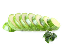 Sliced zucchini and leaf. Royalty Free Stock Photography