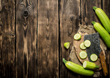Sliced zucchini and an old hatchet . Royalty Free Stock Photography