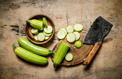 Sliced zucchini and an old hatchet . Royalty Free Stock Photos