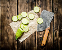 Sliced zucchini and an old hatchet . Stock Image