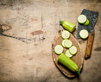 Sliced zucchini and an old hatchet . Stock Photography