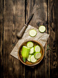 Sliced zucchini and an old knife Royalty Free Stock Image