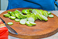 Sliced zucchini on wood board . concept of cooking. Sliced zucchini on wood board Royalty Free Stock Images