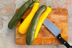 Sliced zucchini on wooden cutting board.  Royalty Free Stock Photography