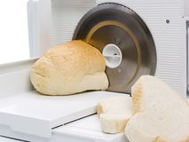 Slicer and bread Stock Images