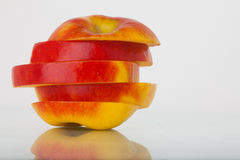 Slices of an apple stock photos