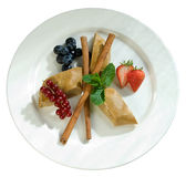 Slices of apple pie with cinnamon and berries Stock Photo
