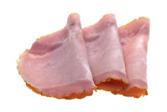 Slices of applewood smoked ham on a white background. Stock Images