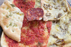 Slices of assorted pizza and salami. Slices of homemade assorted pizza and soppressata salami Royalty Free Stock Photography