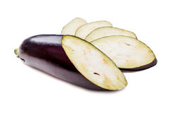 Slices aubergine on the wihte table Royalty Free Stock Photos