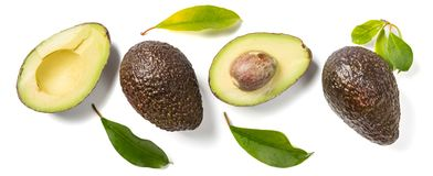 Slices of avocado on white background. Whole and half with leaves. Design element for product label. Top view stock photos