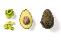 Slices of avocado on white background. Whole and half with leaves. Design element for product label Royalty Free Stock Images