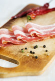 Slices of bacon and pepper Royalty Free Stock Image
