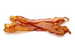 Slices of bacon on white Stock Photo