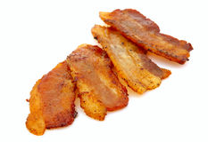 Slices of bacon on white Stock Images