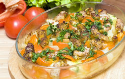Slices of the baked pork with vegetables Stock Image
