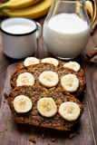 Slices of banana bread and milk Stock Photos