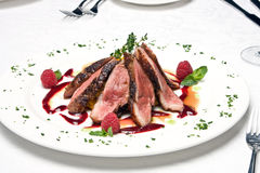 Slices of the beef meat on a dish Royalty Free Stock Photography