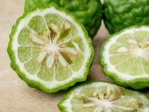 Slices bergamot . Slices bergamot on Chopping Wood royalty free stock photo