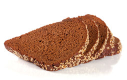 Slices of black bread with sesame seeds isolated on white background.  Royalty Free Stock Photo