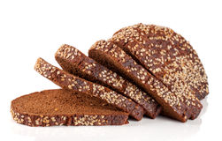 Slices of black bread with sesame seeds isolated on white background.  Stock Photography