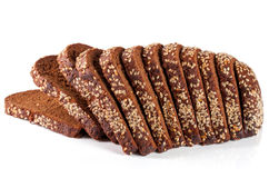 Slices of black bread with sesame seeds isolated on white background.  Stock Photo