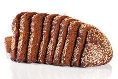 Slices of black bread with sesame seeds isolated on white background.  Royalty Free Stock Images