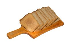 Slices of black bread on a wooden kitchen board stock photo