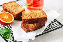 Slices of blood orange vegetarian pound cake on a wire rack. Whi royalty free stock photos